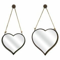 "Set of 2 heart-shaped wall mirrors in rust with hanging bracket and rope detailing.   Product: Small and large wall mirror Construction Material:  Metal, mirrored glass and ropeColor: Rust     Dimensions: Small: 16.5"" H x 17.75"" W x 2.5"" D Large: 20.25"" H x 20"" W x 2.75"" D"