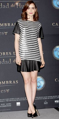 Collins sparkled in a shimmery silver-and-black striped Rachel Zoe tee with leather sleeves, styling it with a pleated leather skirt and black Brian Atwood pumps.