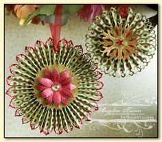 """Rosette Christmas Ornaments - Cut a strip of double sided patterned paper about 2"""" wide by 12"""" long, punch border with border punch, score every 1/4"""" using a scoring board, accordion fold...."""