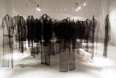 "Claudia Casarino ~ ""Uniform"" (2008) Installation of black tulle uniforms via claudiacasarino.com"
