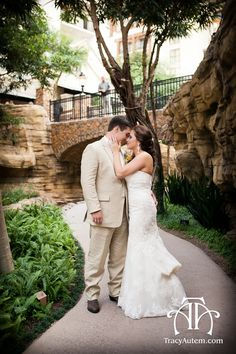 romantic shot of bride and groom along the riverwalk at The Gaylord Texan. Photographed by Tracy Autem Photography. http://tracyautem.com