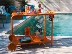 Fill a bar cart with snacks, dry towels, water and a selection of Starbucks VIA® Instant Sweetened Iced Coffee for a midday boost at the pool with family and friends this summer!