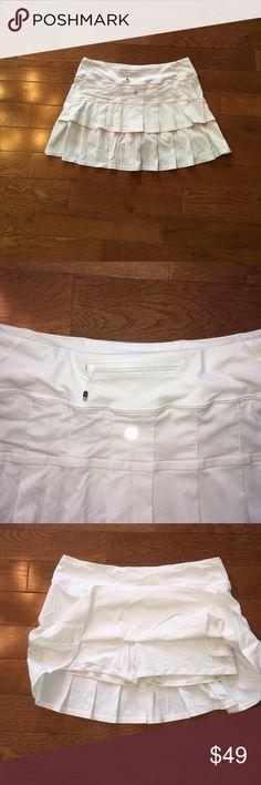 ❤Lululemon pacesetter skirt-8Tall❤ Lululemon pacesetter skirt/skort-bright white!! No flaws,perfect!! Back zip pocket, no slip leg grippers,never ending drawstring waist,tennis ball pocket. Check out my closet for tons of other lulu & athleta skirts-bundle & save!! 🚫lowball offers lululemon athletica Skirts Mini