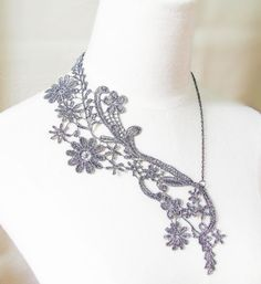 This large silver on black Lace necklace is a unique design. It has vintage and modern style blended together.This lovely accessory makes you stand out