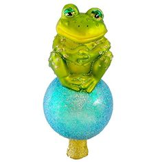 Old World Christmas Frog Sitting on Ball Mouth Blown Glas... https://www.amazon.com/dp/B004ALN1QU/ref=cm_sw_r_pi_dp_x_SIqpybPDRRVYS