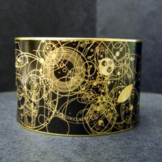 Steampunk Doctor Who Gallifrey Symbols 1 1/2 Inch Brass Cuff. $28.00, via Etsy.  For all the Dr. Who fans!