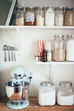 I love this. Dry storage things on open shelves. Beats putting actual dishes on open shelves which collect dust like a mofo