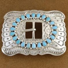 Turquoise Belt Buckle Handmade by Navajo Jimmy Emerson, http://www.nativeamericanstuff.net/Navajo%20Handcrafted%20Belt%20Buckles.htm