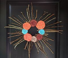 Make a bold statement with on your front door with out breaking your budget.  Use scrap fabric and twigs from your yard for this colorful twig wreath.