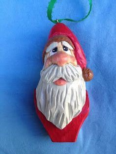 Santa tree ornament carved by me.  See more of my wood carvings on: https://www.etsy.com/shop/rwkwoodcarving