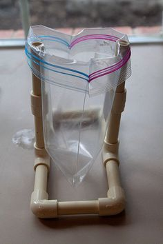 This one-handed bag holder is simply made from PVC. -Courage Kenny Rehabilitation Institute