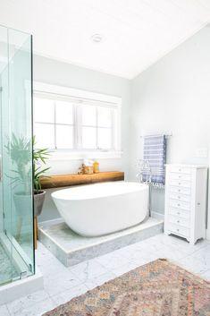 a contemporary bathroom with stand alone bathtub