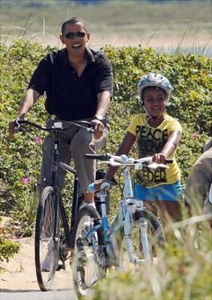 Barack and daughter Sasha is spotted on a bike ride along the Lobersterville beach on Aug. 27. Michelle and Malia are not far behind.