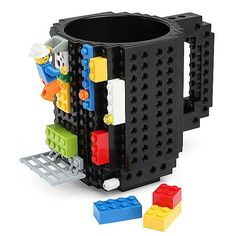 A little tricky to drink from, but a straw fixes that. Cures the random table boredom.Build-On Brick Mug