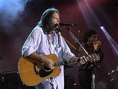 """Neil Young performs """"Sugar Mountain"""" with Willie Nelson and Mickey Raphael at the Farm Aid concert in Louisville, Kentucky on October 1st, 1995. Farm Aid was started by Willie Nelson, Neil Young and John Mellencamp in 1985 to keep family farmers on the land and has worked since then to make sure everyone has access to good food from family farme..."""