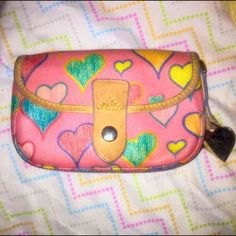 Dooney & Bourke authentic wallet bag Adorable little wallet bag from dooney and Bourke. This shows slight signs of wear on the leather, I tried to show it in the photos. Not too noticeable though! #dooneyandbourke #wallet #wristlet #hearts Dooney & Bourke Bags Wallets