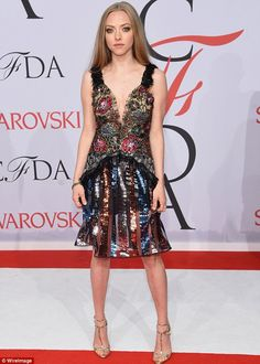 Taking the plunge: Amanda Seyfried rocked an intricate low-cut number at the CFDA Fashion ...