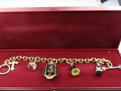A beautiful and unusual Pinchbeck gem set and enamel charm bracelet by Lavenderblooms in London on Ruby Lane