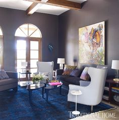 In the living room, dramatic black walls are offset by light reflected from the pool, providing a respite from the bright noon sun. - Photo: William Waldron / Design: Kristin Rocke