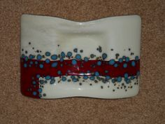 Candle tray with vanilla glass, red and reactive blue