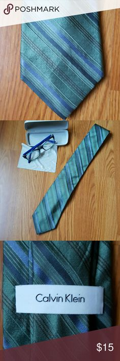"Men's Calvin Klein Tie Styled to perfection; Calvin Klein striped tie in teal & blue; 100% silk; polyester lining: total length 58"" and 3"" width; complentary to any look. Calvin Klein Accessories Ties"