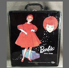 Old Barbie Doll Case- I have this one, but Barbie is wearing a yellow outfit instead of a red one...