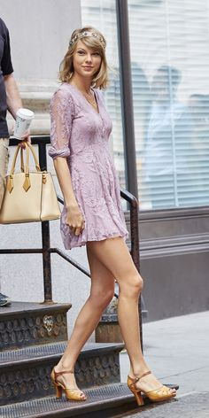 Taylor Swift spotted wearing pink lace and headband while departing her residence in the Tribeca neighborhood of NYC