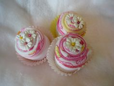 burp cloth cupcakes...adorable! thes would be super cute along with a diaper cake