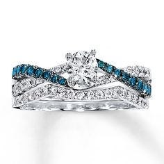 Something blue! This diamowhite gold. Artistry Blue Diamonds™ are treated to permanently create the intense blue color. Diamond Total Carat Weight may range from .83 - .94 carats.
