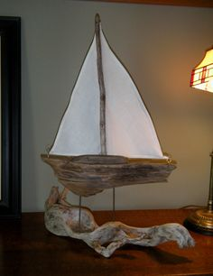 #Driftwood #Sailboat  resting on  fake waves of another driftwood piece.