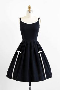 vintage 1950s black + white bows dress.
