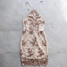 In the same cut as our up all night dress, this beautiful dress consist of a rose gold sequin design throughout. Fabric has some stretch