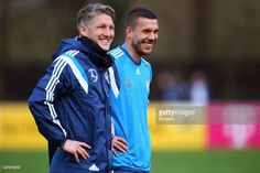Bastian Schweinsteiger and Lukas Podolski attend a Germany training session at Kleine Kampfbahn...