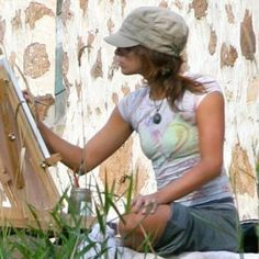 Check out Gretchen Hoehn's page if you want to find a muralist with experience. She paints garden murals, portraits, and some abstract works.