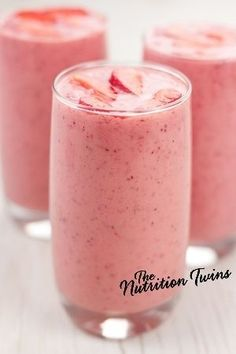 Skinny Strawberry Sunrise Smoothie | Only 169 Calories with 10 Grams Protein | Delicious Way to Get Your Veggies-- there's spinach in there! | For MORE RECIPES, fitness & nutrition tips please SIGN UP for our FREE NEWSLETTER www.NutritionTwins.com