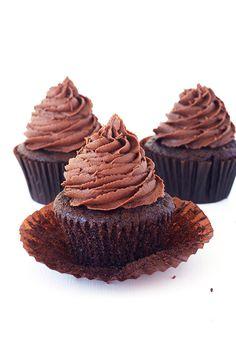 Death By Chocolate Cupcakes - Rich dark chocolate cake with a hidden pocket of chocolate ganache and swirls of creamy dark chocolate buttercream frosting.