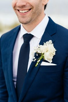 Navy suit with white rose + baby's breath boutonniere {Riverland Studios}