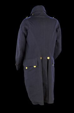 Undress coat of a Captain over three years seniority. This coat, with its straight waist, is of a more fashionable cut than Captain Hoods full dress coat. This may be because there was more latitude in undress to include fashionable elements, or it may be because the coat was made later during this period of regulations. The coat has a heavy tweed interlining, which would have provided added warmth. Although it is a fashionable cut, it should be noted that the uniform coats retain the…