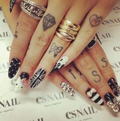 Love the bow finger tattoo