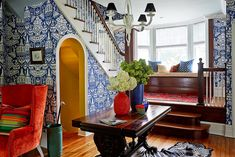 """These 6 Lessons In Color Will Change The Way You Decorate #refinery29  http://www.refinery29.com/one-kings-lane/21#slide-1  Think In Color FamiliesAt first glance, the home's entryway looks like a riot of color, but after talking to Mele, you realize he was actually working with a tight palette. """"I wanted a lot of white, first of all, and then a mix of blue and orange,"""" he reveals. The secret? Working with various hues within each of these two complementary color families. Mele's blues, he…"""
