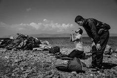 Muslim men pray upon reaching the beach in Lesbos, Greece, Sept. 25, 2015.