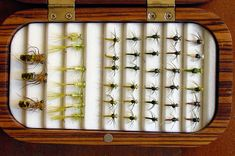 beautiful wooden fly box with assorted fishing flies