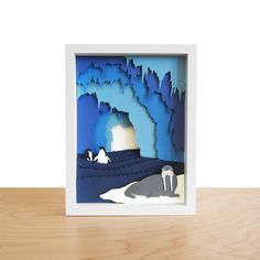 Beautiful  Ice Cave—a three-dimensional illustration—is hand cut and assembled by the Han-Made designer in Brooklyn. Featuring a walrus in the forefront and two playful penguins behind him, this piece really brings the chilly environment to life!