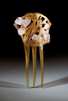 French Art Nouveau comb decorated with pearly pink flowers painted on horn, c. 1900.