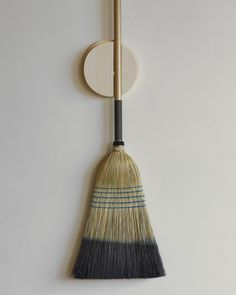 The Broom Holder keeps our Barn Broom in good shape their next use while storing it neatly on the wall. The round puck inside holds the broom in place by creating tension with the opposite side when t