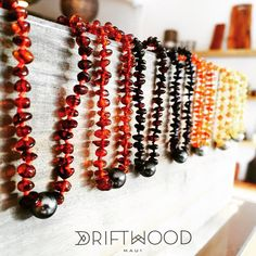 For the wee one's. Baby teething necklaces with Tahitian Pearls in yellow, red and black amber. #amber#love #madeonmaui #maui  Driftwood Maui - A Lifestyle Boutique In Makawao, HI