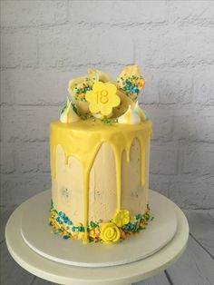 18th birthday cake. Yellow drip cake.