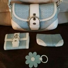 NWOT Coach Set Brand new never used, without tags. Price includes the entire set, purse, wallet, zippy and fob. Coach Bags Shoulder Bags