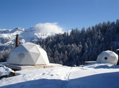 WHITEPOD Les Giettes, Switzerland  Leave it to the French-speaking Swiss to make a romantic geodesic dome. These 15 pods come with wood-burning fireplaces, organic-cotton sheets, private baths, and minimalist-yet-groovy decor that would be at home in a copy of Stern magazine circa 1976.