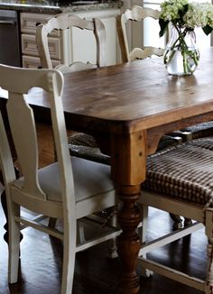 Love the stained table and white washed chairs